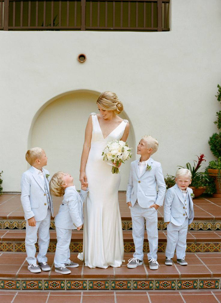 Bride and the boys. Photography: Marisa Holmes - marisaholmesblog.com  Read More: http://www.stylemepretty.com/little-black-book-blog/2014/05/19/intimate-la-jolla-wedding/