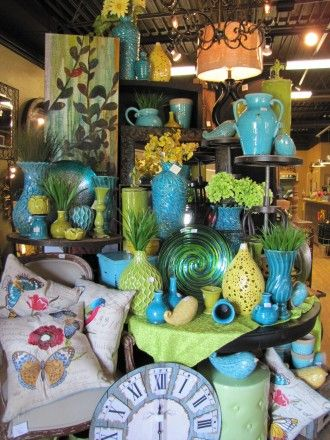 visual merchandising for home decor big clock great blue tourquoise vases and accessories - Home Decor Stores