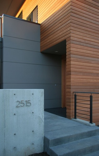 Wood cladding & concrete. Looks good. We could use grey render.
