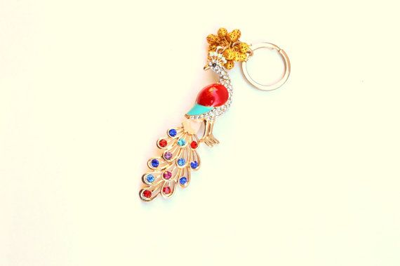 An impressive #Peacock #Key Chain to put your  home or #car keys.. From a metal gold color  ring ,hanged an #enameled #beaded Peacock and filgree golden beads.  Another idea is ... #keychain #brelock #keys #house #key #holder #housewares #decoration #glossy #gemstones #peacock