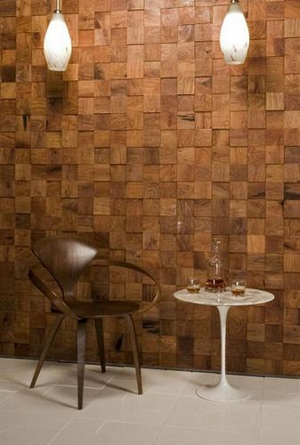 I like this accent wall.  4x4's cut and mounted with adhesive. End grain showing.