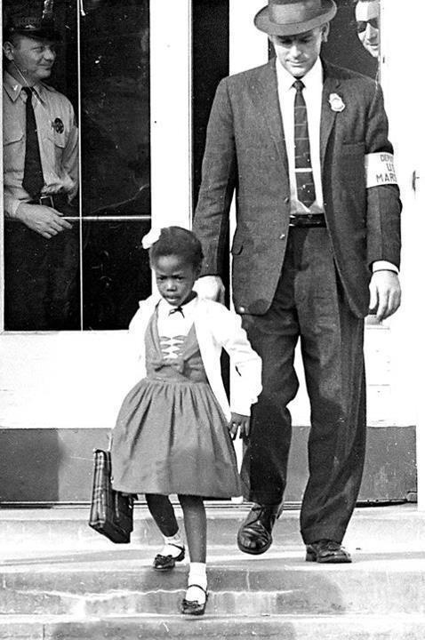 Pictured: U.S. Marshals escorting the very brave Ruby Bridges, 6 yr old, to school in 1960 -  Courageous Ruby Nell Bridges Hall, born September 8, 1954, is known as the first black child to attend an all-white elementary school in the South in 1960, despite the enormous pressure and hatred from white citizens.