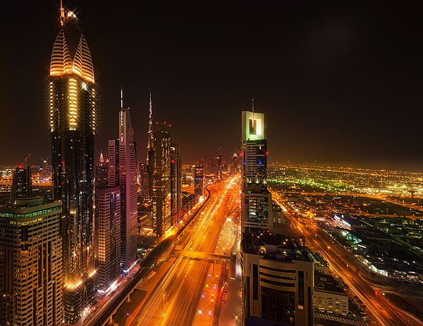 Colors of Midnight in Dubai by Elena Riim.   Panoramic view of midnight Dubai from top.