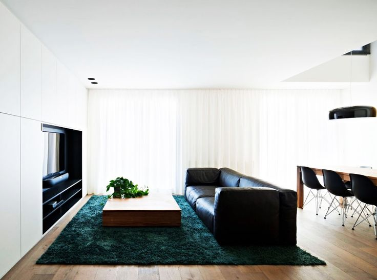 Home Design, Fascinating Vivienda En Arnedo Home Family Room Enhanced With Green Rug To Hit White Painted Center Wall And Ceiling: Fantastic Modern Contemporary House Design Ideas With Monochrome Theme
