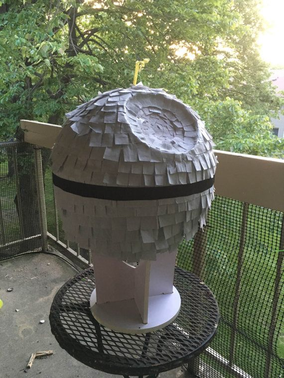 The Smaller of the two, This is a Death Star inspired pinata that is great for any kind of party you would want to destroy the Death Star at. Made from Recycled news paper, flour, and tissue paper.  There is a flap with a pull tab on the back to put in your own candy and prizes. The pinata is about 20in in diameter and can hold 10 lbs of candy or more. Item is hand made and may vary slightly in size.   * Please indicate the date you need the pinata by in the notes when making your purchase…