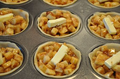 Perfect sized Apple Pie made in muffin pans. I wish I'd known about this a long time ago! I'm really loving all these muffin pan recipes I've been seeing on Pinterest lately.