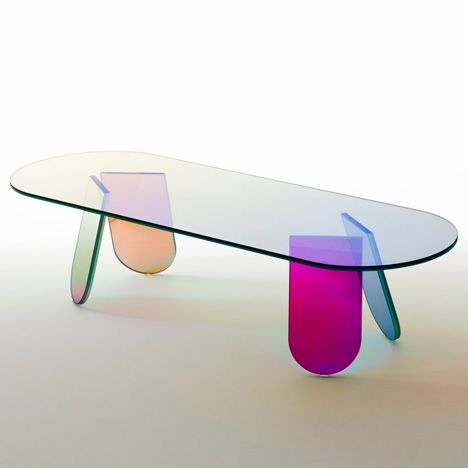 Spanish designer Patricia Urquiola has overcome her hatred of glass to design a collection of iridescent furniture and mirrors using the material.
