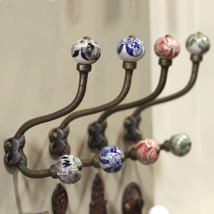 Brighten up your hallway with these stunning hand painted ceramic coat hooks.  Come with screws and can be attached to the back of a door or in the  hallway.