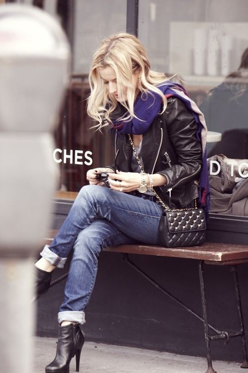 leather jacket, cuffed jeans, heeled boots.