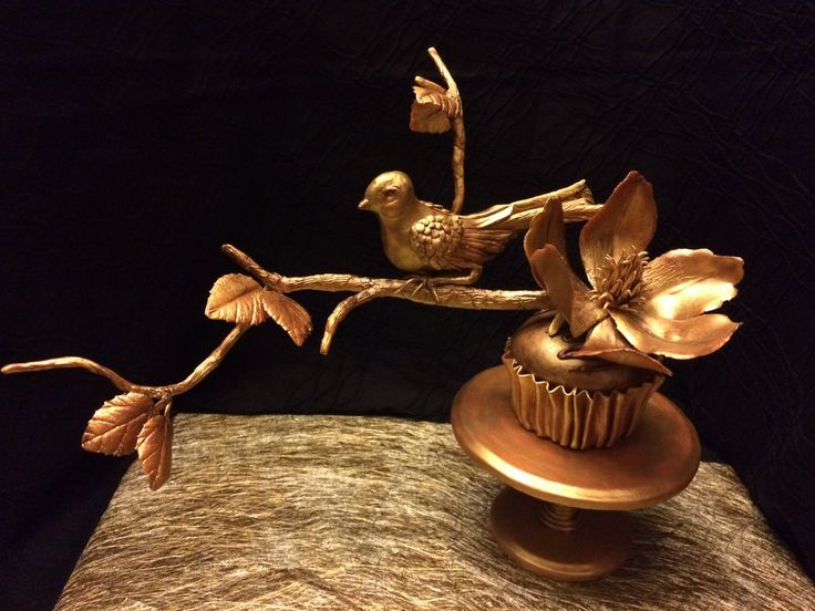 Golden bird, magnolia on a cupcake made with Yenji toy clay