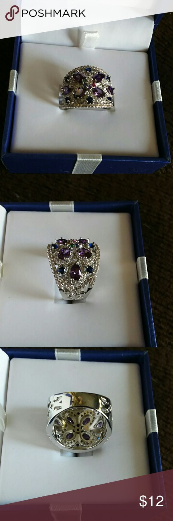 NEW HIGH QUALITY COSTUME JEWELRY RING NEW HIGH QUALITY COSTUME JEWELRY RING  KNUCKLE TO KNUCKLE FIT  PURPLE STONES WITH FLORAL DESIGN  VERY PRETTY RING Jewelry Rings