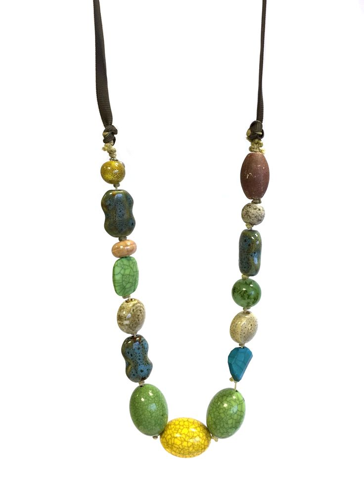 Carolyn - One Button mixed ceramic/acrylic beads on grosgrain ribbon necklace #teal #lime #gorgeousgreens #necklace #accessories #onebutton Click to buy from the One Button shop.