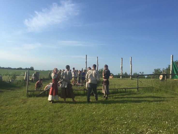 whatching kids shooting bow and arrow. viking trelleborg
