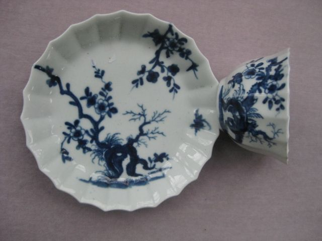 A Worcester fluted  tea bowl and saucer painted with the Prunus Root pattern. (BFS 1D27)  Workmans marks   Circa 1758