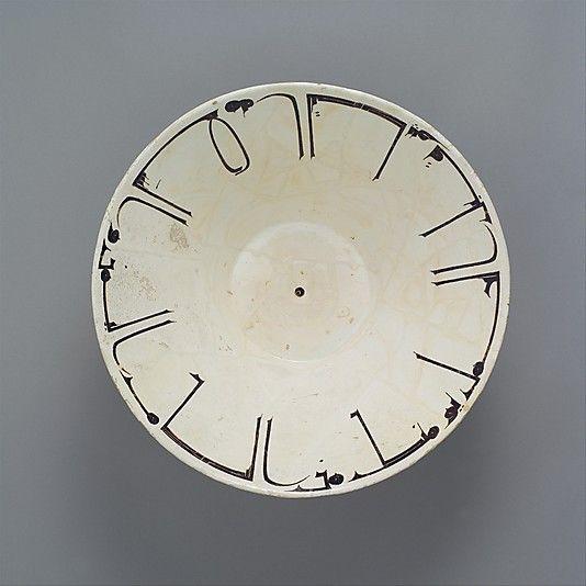 10th century Iran- Earthenware; white slip with black-slip decoration under transparent glaze