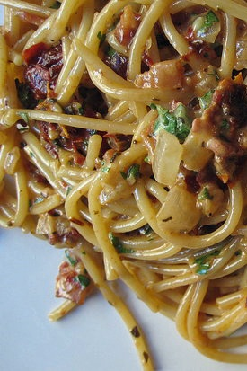 Spaghetti with Creamy Sun-Dried Tomato an Bacon Sauce.  4 1/2 stars. I changed things a little bit, including using the entire package of bacon, not just the 5 strips they called for.
