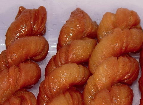 Koeksusters (pronounced kooksisters) - one of South Africa's best sweet things. Drool - soaked in syrup and cinnamon.