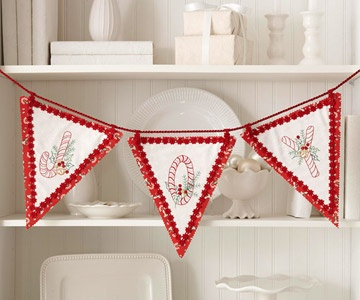 Pretty embroidery makes this joyful banner a special Christmas gift that sets the scene for a merry holiday.
