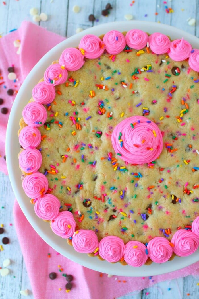 this funfetti giant chocolate chip cookie cake has party written all over it mak chocolate chip cookie cake giant chocolate chip cookie chocolate chip cookies this funfetti giant chocolate chip