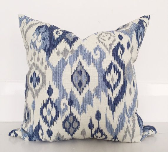 Coastal blue ikat cushion.  This etsy shop in WA has beautiful cushions. 2 of these on the bed or 1 on the chair
