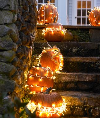 White Christmas lights wrapped around pumpkins - cute!