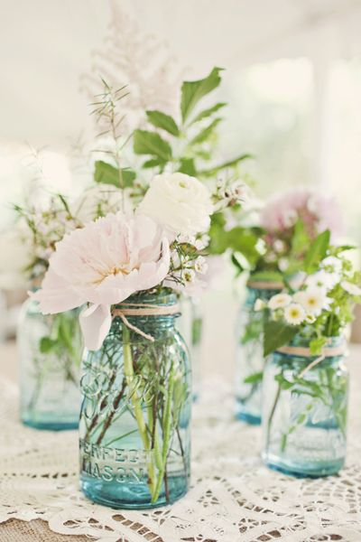 Soft coloured flowers in blue jars