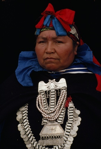 Chile | A Mapuche machi or healer in traditional headdress and clothing. Temuco.