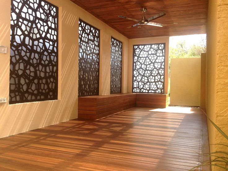 'Pretoria' decorative screens fill the window space of this gorgeous back studio. These screens were cut in compressed hardwood. By QAQ, made in Melbourne, Australia.