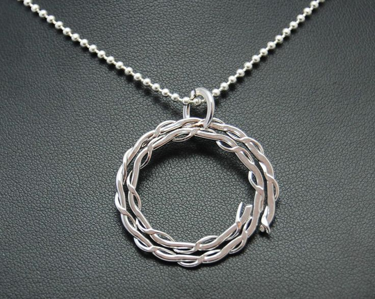 Necklace with pendant in the shape of a circle woven. Electroformed copper, silver plating and rhodium.