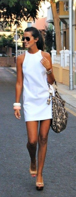 Street style | Retro white dress, heels, statement bracelets, handbag
