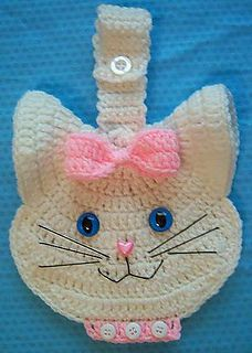 A delightful kitty is waiting for you to crochet and hang in your kitchen to keep you company!