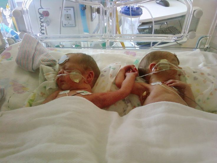 My twins holding hand in the nicu what a blessing