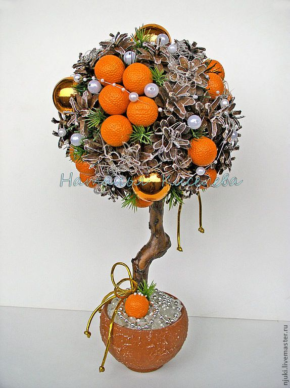 Winter topiary made with tangerines and cones