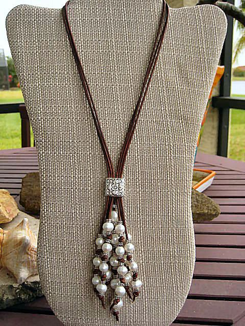 "Diva Tahitian Style Creamy White Baroque Fresh by LeatherDiva, $109  Reddish brown or Black very soft leather has been adorned with bunches of luxurious hand drilled creamy white baroque fresh water pearls, Artisan silver or gold focal piece, Tibetan silver or gold beads in a lariat style necklace and has a sterling silver filled lobster claw clasp with adjustable chain and pearl dangle (19"" + 5"" dangle)"