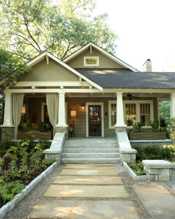 A Virginia-Highland Bungalow channels its Craftsman roots.  1920's house.  Front porch is long, wide, and has a side porte cochere.  Long custom planters eliminate the need for railings and provide privacy for the seating area.