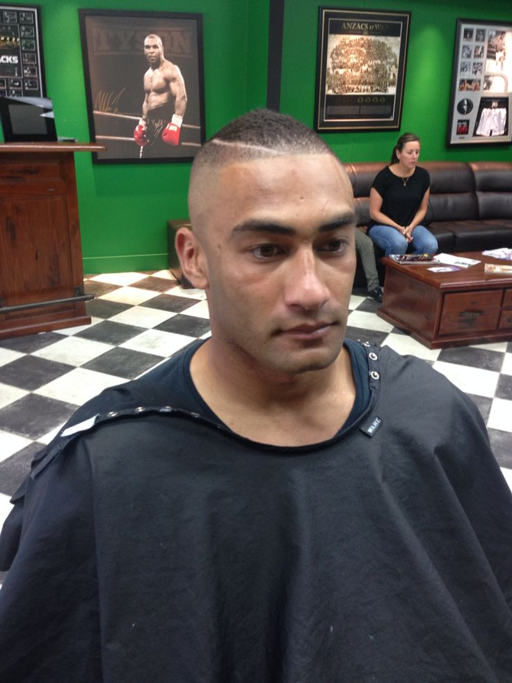 High razor fade into Mohawk with a line
