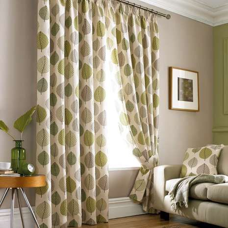 Featuring a fresh green leaf motif over a natural background, these pencil pleat curtains are fabricated from cotton for utmost quality and softness, ready made...