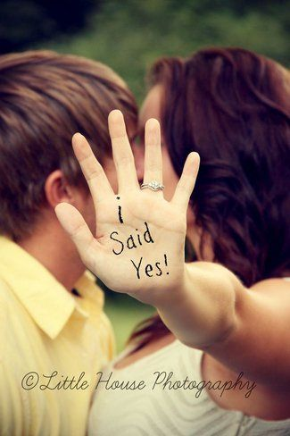 """Speak to the hand"" photo idea that lets you show off your engagement ring while simultaneously announcing that you said yes! Double score!"