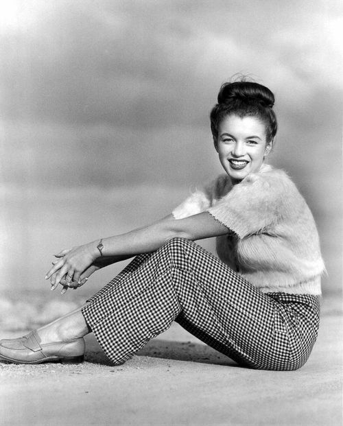 That hair bun is still trending. Norma Jeane (1945), the real Marilyn, Marilyn Monroe.Marilyn Monroe, I understand her I have been attracting men since 7 years old, I had similar body to Norma Jean when she was young after I was not sexy at all but men went nuts on me even dressed with my winter coat and looking as a pouch of potatoes caring groceries,http://www.ninaohmanarts.com