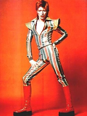 Artist:  David Bowie / 1972.  #Bowie brings #androgyny to mainstream audiences with his Ziggy Stardust-era get-ups.  #subvert1970s