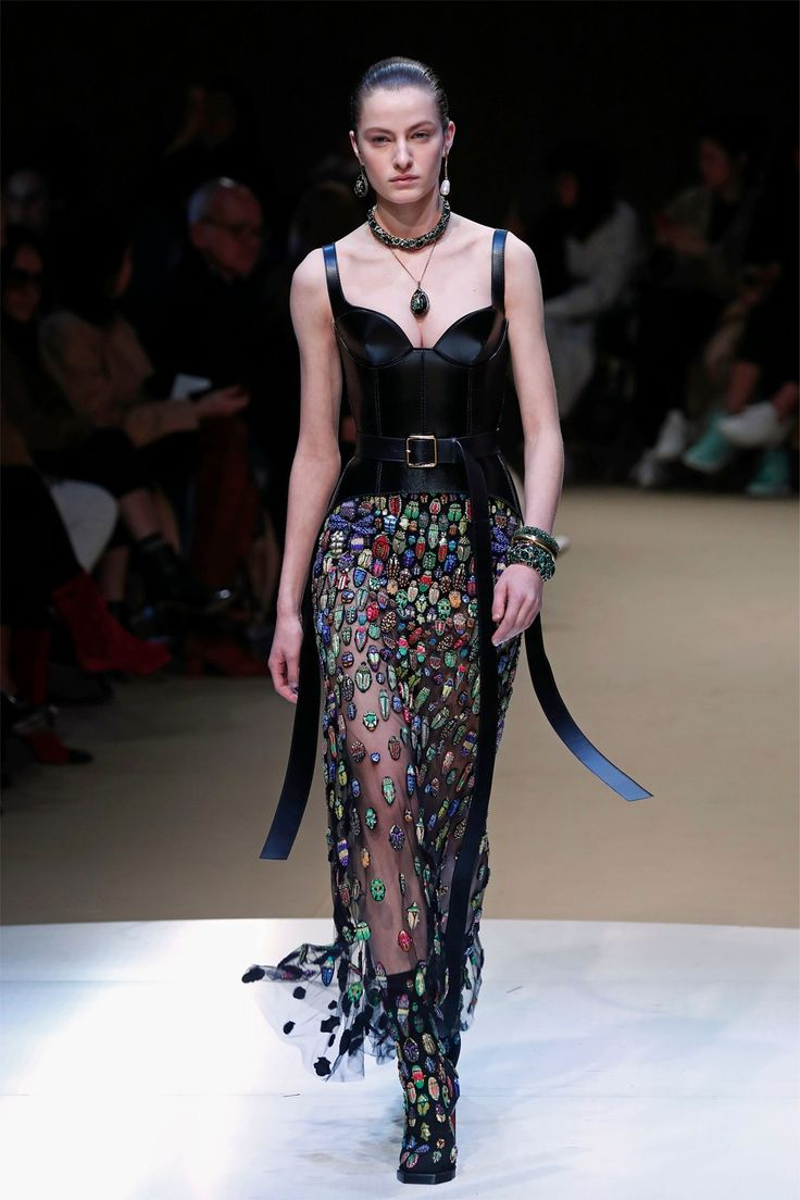 A corset-like leather top is paired with a transparent skirt featuring colourful beetles. Photo: AFP