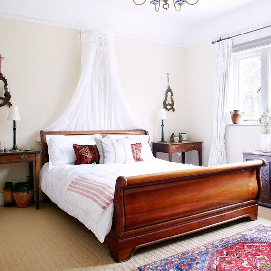 Romantic bedroom with sleigh bed and voile curtain