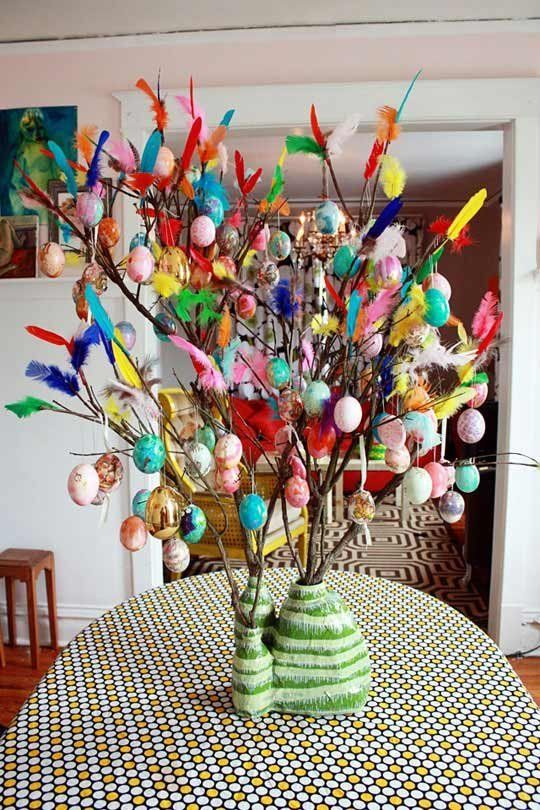 Paskris, a Swedish Easter tradition of decorating branches with brightly colored feathers, and sometimes add eggs to bring the sunshine inside.