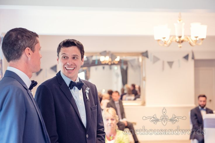 Groom and best man laughing before Balmer Lawn Hotel Wedding ceremony. Photography by one thousand words wedding photographers