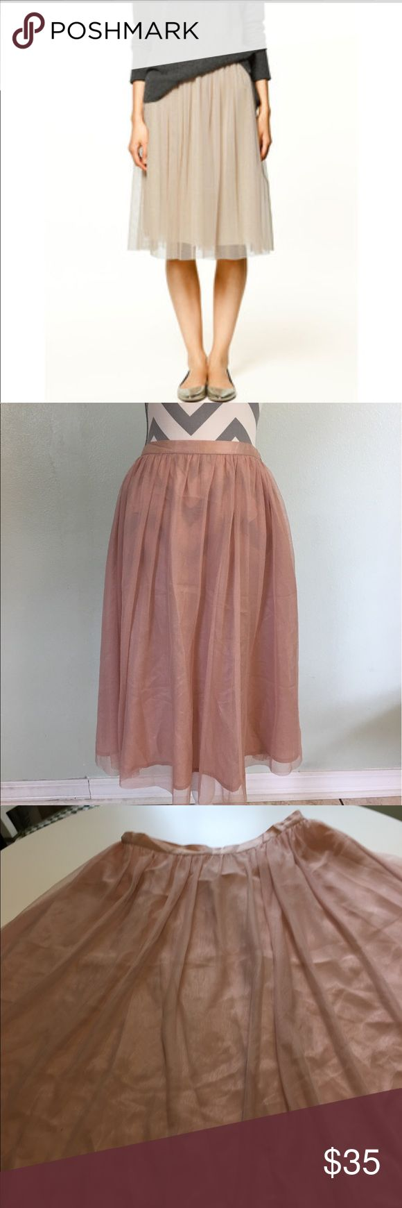 🎉HP 6/5/17🎉Zara Tulle Skirt This tulle skirt is satin style lining with tulle over lay.  Front waist satin look and back is elastic stretch.   Last pic shows 3 pin size spots. Not noticeable when wearing.   On tulle so dry clean and should come off.  Pricing low to help with dry cleaning.            (pk#22) Zara Skirts Midi