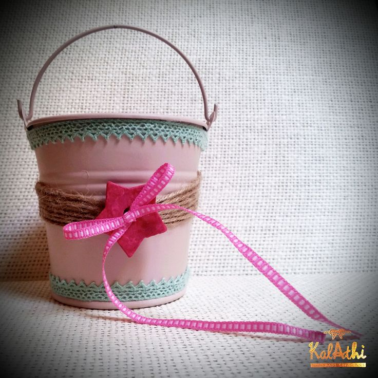 Tin can with lace and ceramic ornament by KalAthi photo © KalAthi