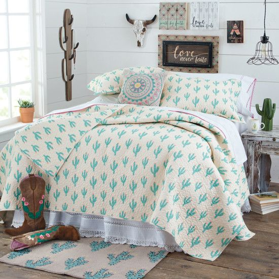 Cowgirl Cactus Quilt- There's nothing prickly about this all-over cactus print bedding! The whimsical quilt features turquoise cacti blooming with pink flowers on a soft cream background.