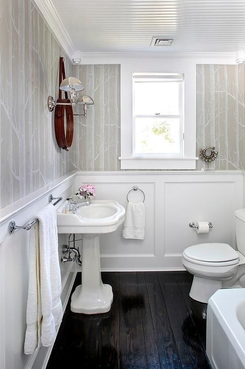 Dark lacquered wood floors provide the perfect contrast to for Bathroom ideas dark floor