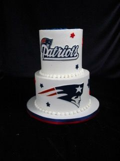 two tier buttercream cake, patriots cake, football