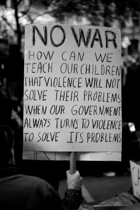 """""""No war! How can we teach our children that violence will not solve problems when our government always turns to violence to solve its problems?"""""""